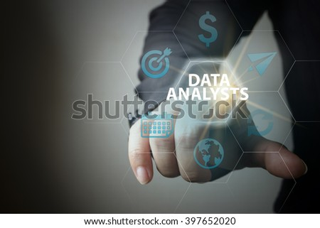 business hand pressing  interface and select DATA ANALYSTS button , business concept , business idea , strategy concept