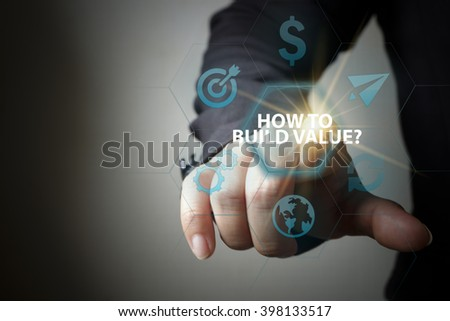 business hand pressing  interface and select HOW TO BUILD VALUE button , business concept