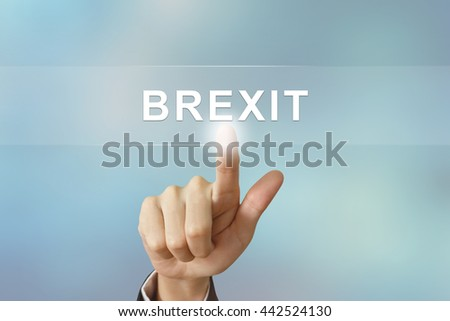 business hand pushing brexit or british exit button on blurred background