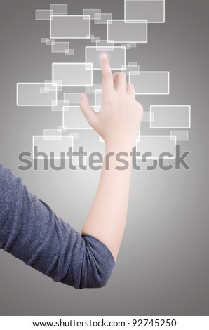 Business hand pushing button on touch screen.