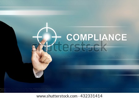 business hand pushing compliance button on a touch screen interface - stock photo