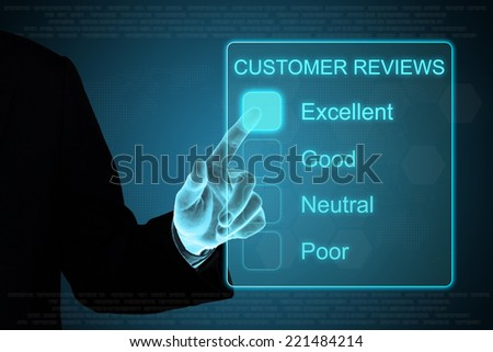 business hand pushing customer review feedback on a touch screen interface  - stock photo