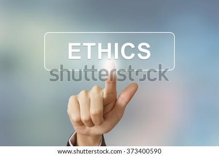 business hand pushing ethics button on blurred background