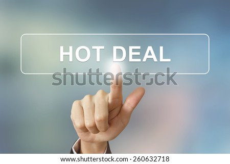 business hand pushing hot deal button on blurred background - stock photo