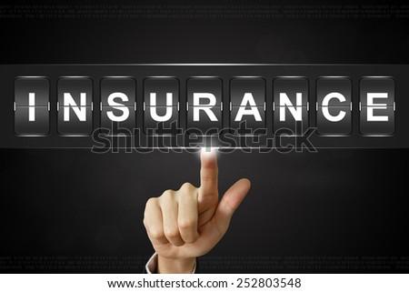 business hand pushing insurance on Flipboard Display - stock photo