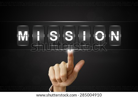 business hand pushing mission on Flipboard Display - stock photo