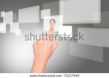 Business hand pushing on a touch screen interface - stock photo