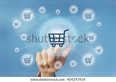 business hand pushing online shopping button with global networking concept - stock photo