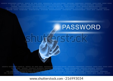 business hand pushing password button on a touch screen interface  - stock photo
