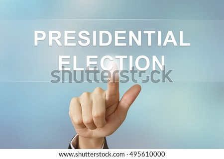 business hand pushing presidential election button on blurred background