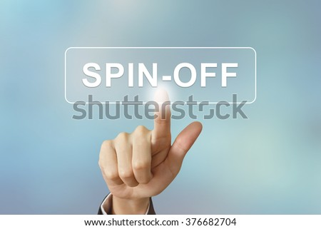 business hand pushing spin off button on blurred background