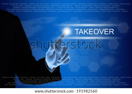 business hand pushing takeover button on a touch screen interface  - stock photo