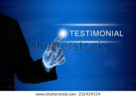 business hand pushing testimonial button on a touch screen interface  - stock photo