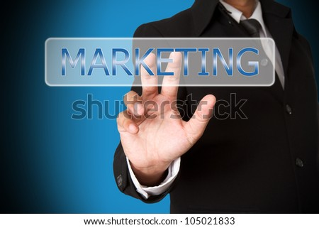 business hand pushing the marketing  virtual button as concept
