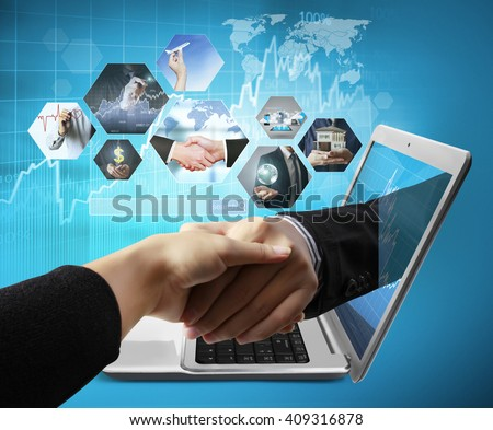 Business  hand reaching out from screen laptop shake Hand from notebook  - stock photo