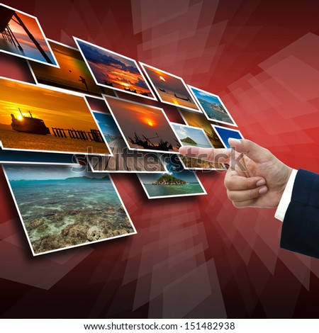 Business hand selecting business icon on medern red abstract background.