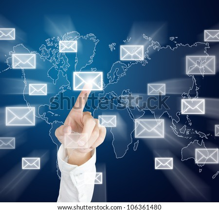 business hand sending by pushing letter sign on touch screen - stock photo