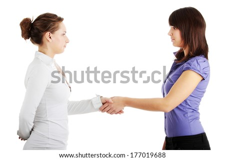 Business hand shake between two colleagues woman  - stock photo