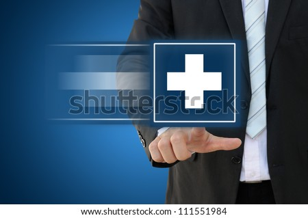 Business hand touch first aid sign - stock photo
