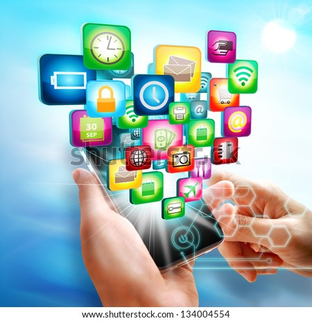 Business hand touch screen mobile with business symbols icons - stock photo