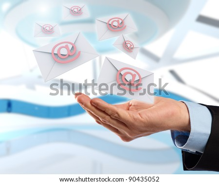 Business hand with email messages flying, concept of future technology in delivery of letters. - stock photo