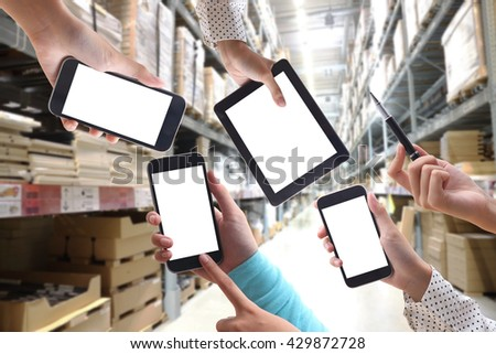 Business hand working with technology social  or Many hand in the tablet PC, and warehouse background - stock photo