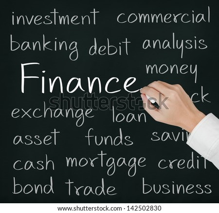 business hand writing finance concept