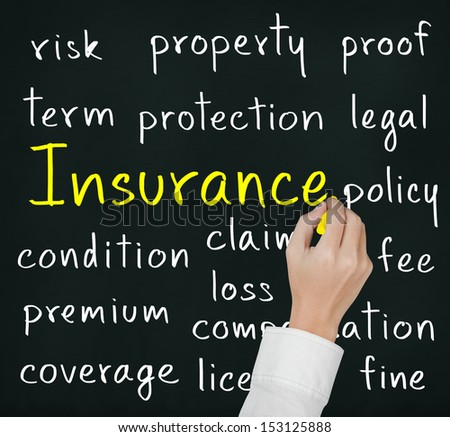 business hand writing insurance concept