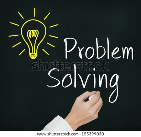 business hand writing problem solving light bulb - stock photo