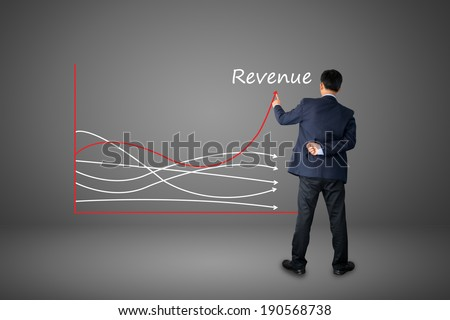 business hand writing revenue graph concept.  - stock photo