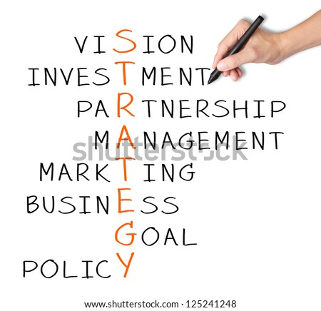 business hand writing strategy concept by crossword - stock photo