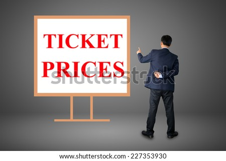 Business hand writing TICKET PRICES  - stock photo