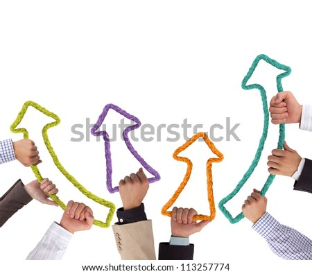 Business hands holding colorful arrows pointing upwards - stock photo