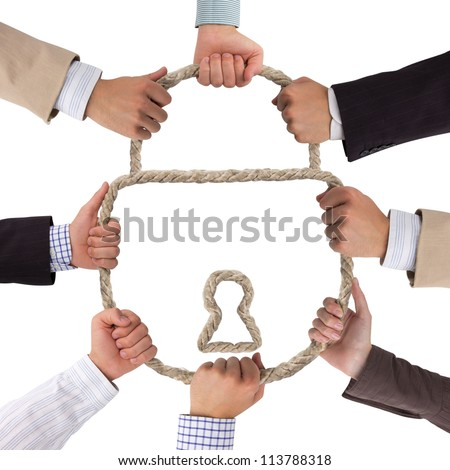 Business hands holding rope forming lock - stock photo