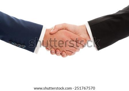 Business hands shaking isolated on white studio background - stock photo