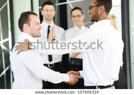 Business handshake after signing new contract - stock photo