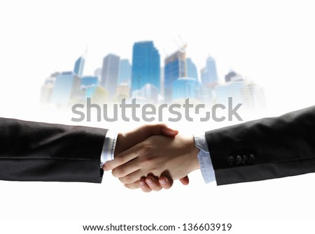 business handshake against white background with city image