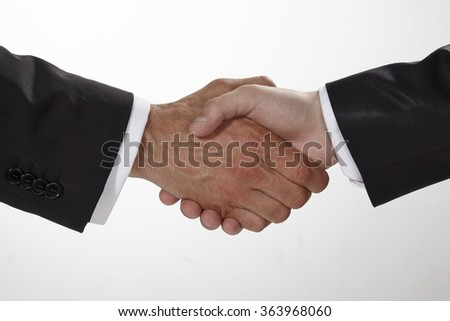 Business handshake and business people concepts. Two men shaking hands isolated on white background.  - stock photo