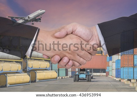 Business handshake and business people on forklift handling the container box and Fuel tank in logistic zone - stock photo