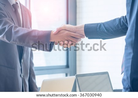 Business handshake and business people.Vintage tone Retro filter effect,soft focus,low light. - stock photo