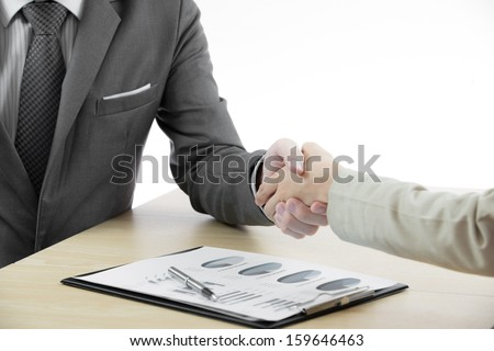 Business handshake and business people with Business Report