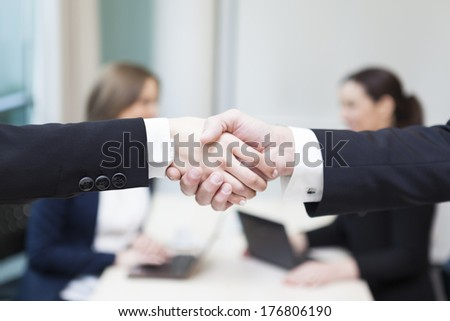 Business handshake at the office - stock photo