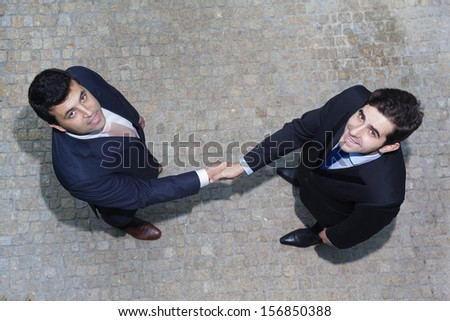 Business handshake between two businessman outdoors - stock photo