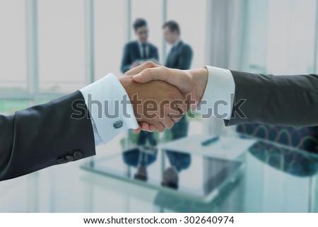 Business handshake, business globalization concept - stock photo