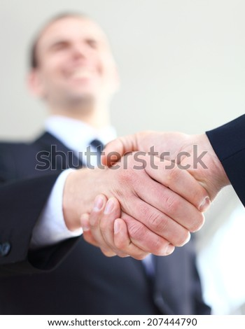 Business handshake. Business man giving a handshake to close the deal