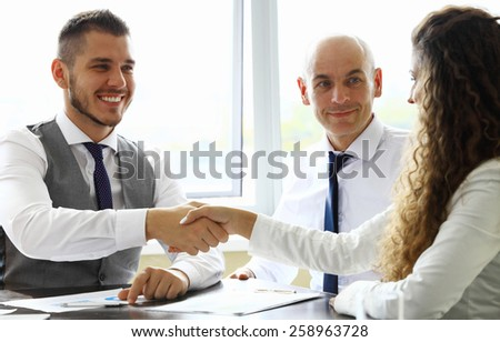 Business handshake. Business people shaking hands, finishing up meeting
