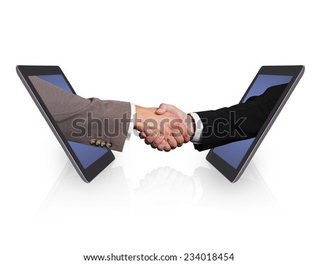 Business handshake emerging from digital tablets isolated over white background - stock photo
