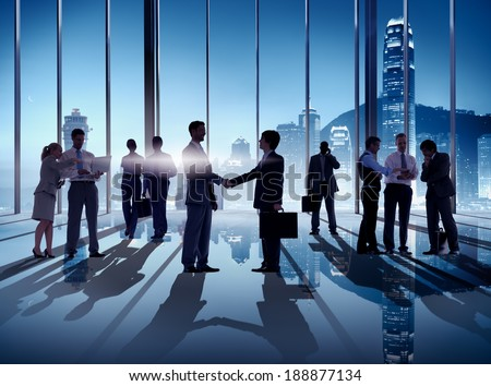 Business Handshake in Hong Kong Office - stock photo