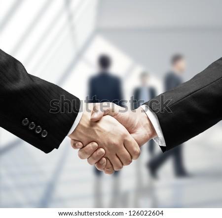 business handshake in loft room - stock photo