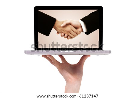 business handshake in modern laptop, isolated on white